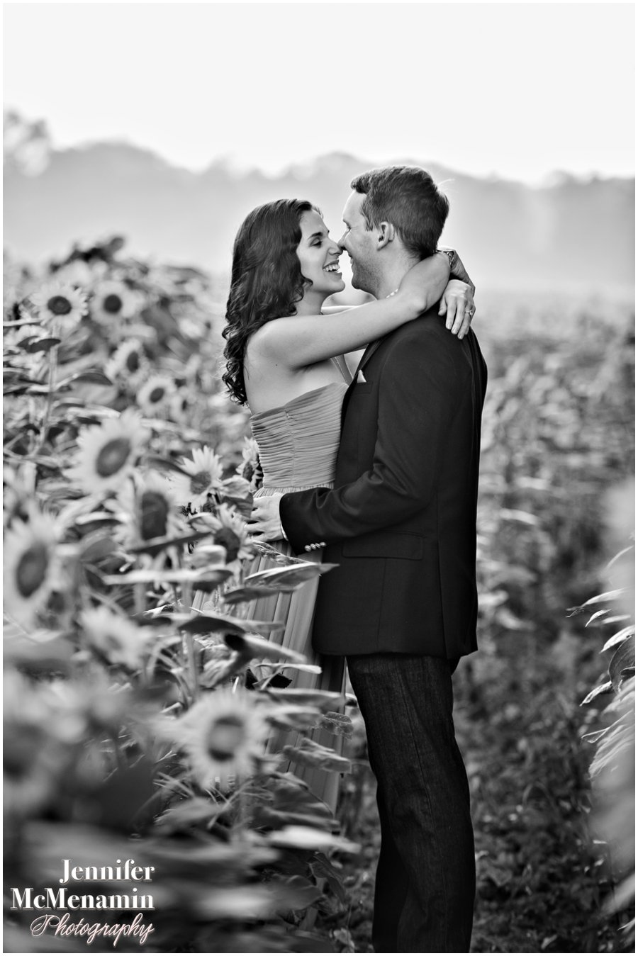 15-BlumWilliams_0374bw-0094_JenniferMcMenaminPhotography_sunflowers_engagement-photos_DC_Baltimore