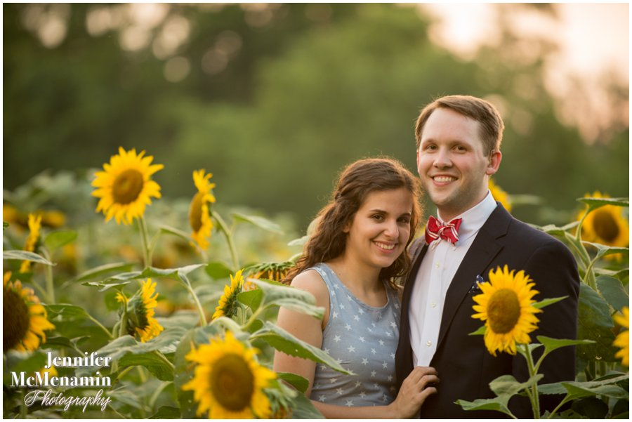 22-BlumWilliams_0626-0144_JenniferMcMenaminPhotography_sunflowers_engagement-photos_DC_Baltimore